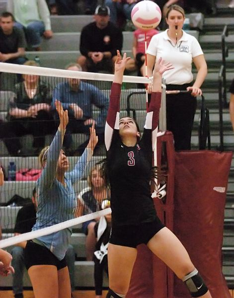 by: DAN BROOD - ABOVE THE NET -- Sherwood junior setter Danielle LeBlanc sets the ball up high during the Lady Bowmen's NWOC match with Liberty. Sherwood scored a three-game sweep of the Falcons.