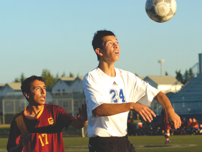 by: THE OUTLOOK: DAVID BALL - Greshams Christian Flores plays a ball off a throw-in during the first half of the Gophers 3-1 loss to Central Catholic on Tuesday.