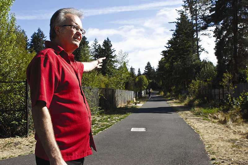 by: JAIME VALDEZ - Garden Home resident Stan Houseman shows a stretch along the Fanno Creek Regional Trail that's been dug up twice in recent years to fix or replace sewer pipes leading from the 12-year-old pumping station on Southwest 86th Avenue.