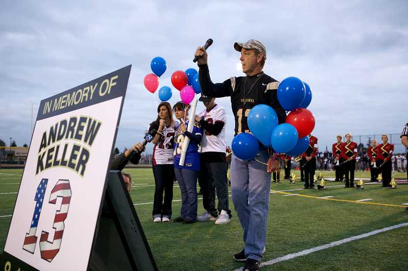 by: JAIME VALDEZ - Jeff Keller thanks community members Friday night for their support after his eldest son, U.S. Army Pfc. Andrew Keller, was killed in action Aug. 15 while serving in Afghanistan. Southridge High School retired Andrew's football jersey No. 13 as a tribute to the former captain and 2007 Most Valuable Player of the Skyhawks football team.