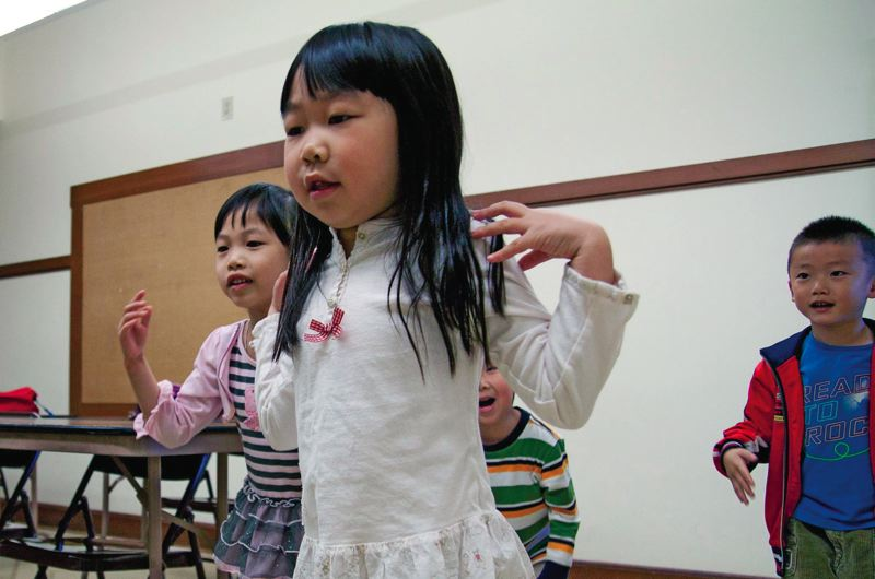 by: TRIBUNE PHOTO: ADAM WICKHAM - Sarah Dear practices 'Head, Shoulders, Knees and Toes,' at her Chinese language school. While Portland's Chinese, Korean and Japanese communities are thriving overall, other less visible Asian ethnicities are falling behind.