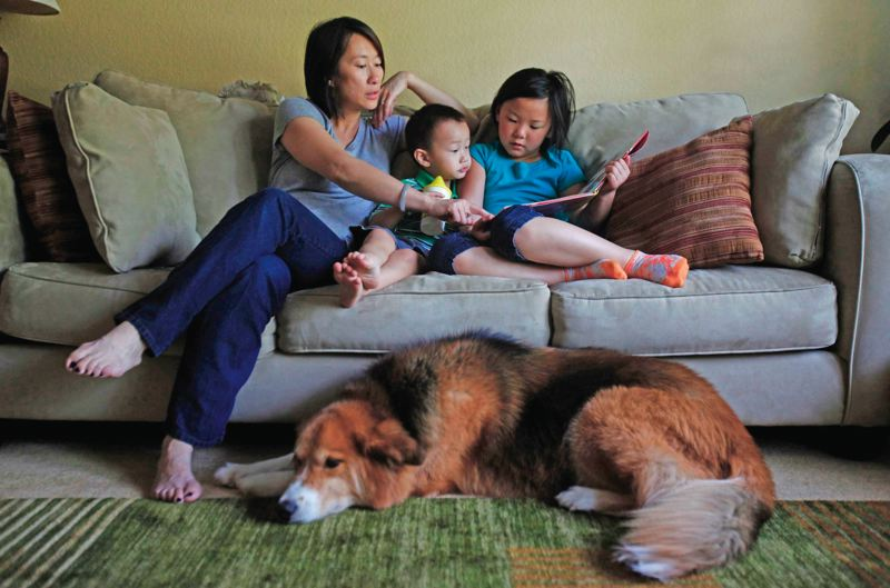 by: TRIBUNE PHOTO: JONATHAN HOUSE - Linda Liu, reading with children Devon and Keira, resents being stereotyped as a Tiger Mom and worries about Asian kids who do not meet the expectation of the Asian super student.