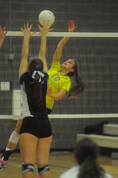 by: MATTHEW SHERMAN - West Linn senior Emma Jones looks to spike a ball over a Lakeridge blocker during last week's match. West Linn lost to Lakeridge in four sets but would rally on Tuesday to knock off Canby.