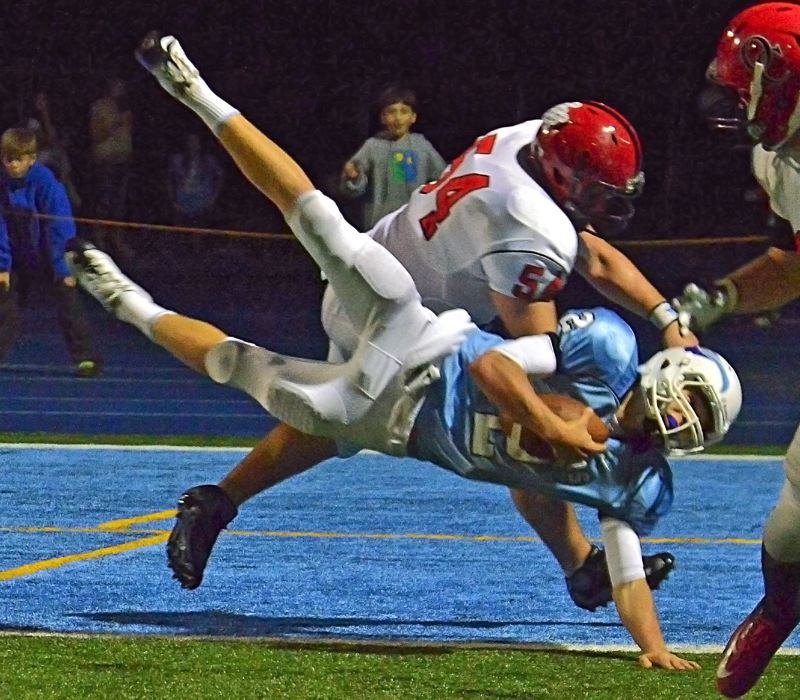 by: VERN UYETAKE - Lakeridge quarterback Eric Dungey is upened as he tried to score during last week's game against Oregon City. He was ruled down at the one-yard line but would score on the next play.