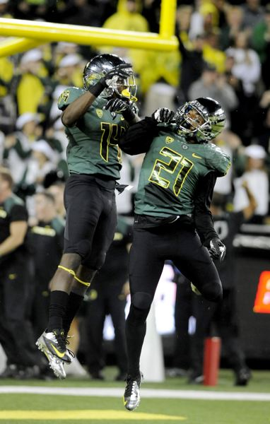 by: TRIBUNE PHOTO: GREG WAHL-STEPHENS - Oregon defensive backs Ifo Ekpre-Olomu (left) and Avery Patterson celebrate a stop in last week's 49-0 home win over Arizona.