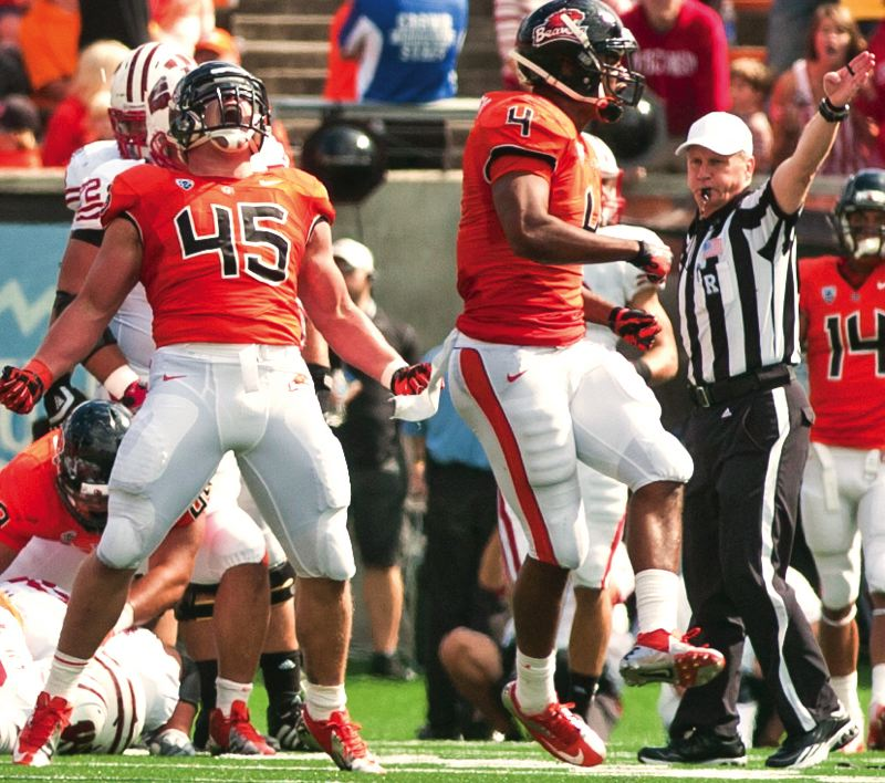 by: OREGON STATE UNIVERSITY - Defensive end Dylan Wynn (left) celebrates a big play by the 2-0 Oregon State Beavers, who visit Arizona on Saturday.