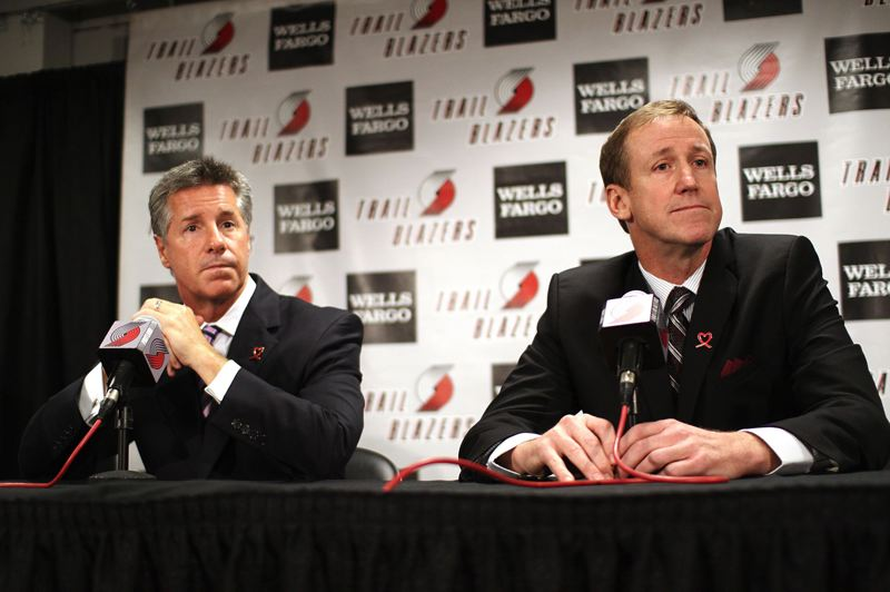 by: TRIBUNE PHOTO: ADAM WICKHAM - Trail Blazers coach Terry Stotts (right), with general manager Neil Olshey, has determined his style of attack and the duties of his assistant coaches, among other things, for the start of training camp next week.