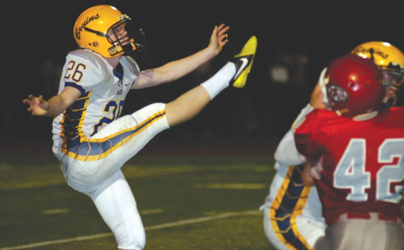 by: THE OUTLOOK: DAVID BALL - Barlow punter Zach Standish lets loose with a kick in the fourth quarter of Fridays 14-12 win over David Douglas. His two extra points proved to be the difference.
