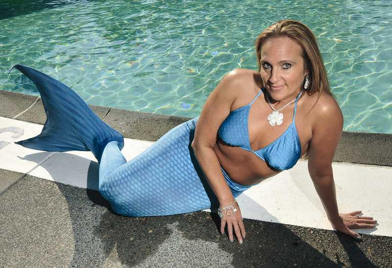 by: REVIEW, TIDINGS PHOTO: VERN UYETAKE - Posing prettily at poolside, Collette Remsen is planning to take her mermaid act right to the altar at her wedding ceremony in the spring of 2013.