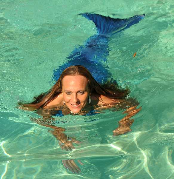 by: REVIEW, TIDINGS PHOTO: VERN UYETAKE - A certified lifeguard, Remsen goes underwater to demonstrate her skill. She says being a great swimmer is absolutely essential for any mermaid aspirant.