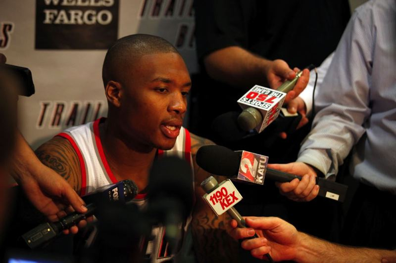 by: TRIBUNE PHOTO: JONATHAN HOUSE - Rookie point guard Damian Lillard answers questions at Monday's Trail Blazers media day.