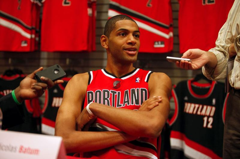 by: TRIBUNE PHOTO: JONATHAN HOUSE - Back with the Trail Blazers, Nicolas Batum says he is looking forward to the NBA season.