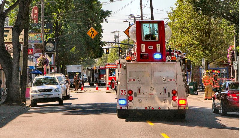 by: DAVID F. ASHTON - S.E. Milwaukie Avenue in Westmoreland is blocked by fire rigs, as they investigate a broken gas line.
