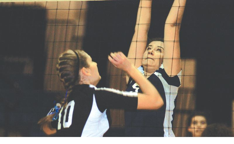 by: PAMPLIN MEDIA GROUP: DAVID BALL - City Christians Alyssa Heard puts up a block against Portland Lutherans Kaitlin Howard during the Lions five-set win Tuesday night.