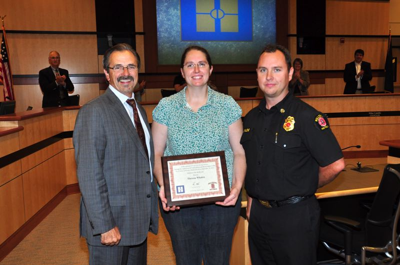 by: HILLSBORO FIRE DEPARTMENT - Theresa Whalen receives a Life-Saver Award from Hillsboro Fire Administrative Chief Scott Malone and Hillsboro Mayor Jerry Willey (left) for using C-P-R to save a man's life on September 18.