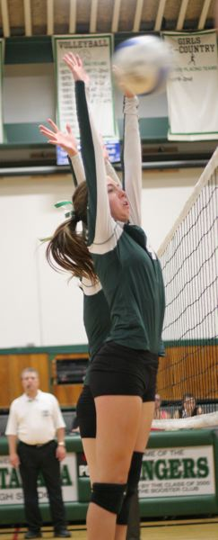 by: PHOTO BY LOREN NIBBE - Sophomore Sarah Davies goes up for the block as the Rangers dominated the net against Molalla and earned a 3-0 sweep.