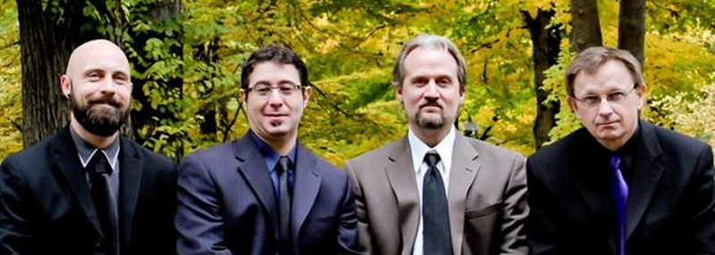 by: SUBMITTED PHOTO - From left are Jesse McCann, John Mery, David Franzen and Bryan Johnson of Oregon Guitar Quartet, who will perform at the Silver Jubilee Concert Saturday at Marylhurst University.