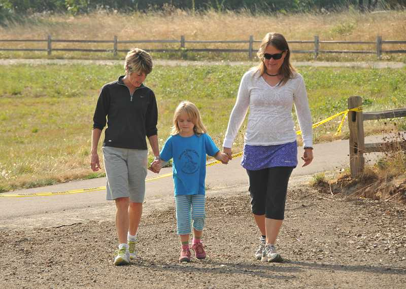 by: VERN UYETAKE - Debbie Craig, left, walks along the new pathway with Janye Cronlund and her daughter, Rose O'Neill. Craig was on the board Three Rivers Land Conservancy of Lake Oswego. Cronlund was the executive director of Three Rivers when the path was first planned 12 years ago.