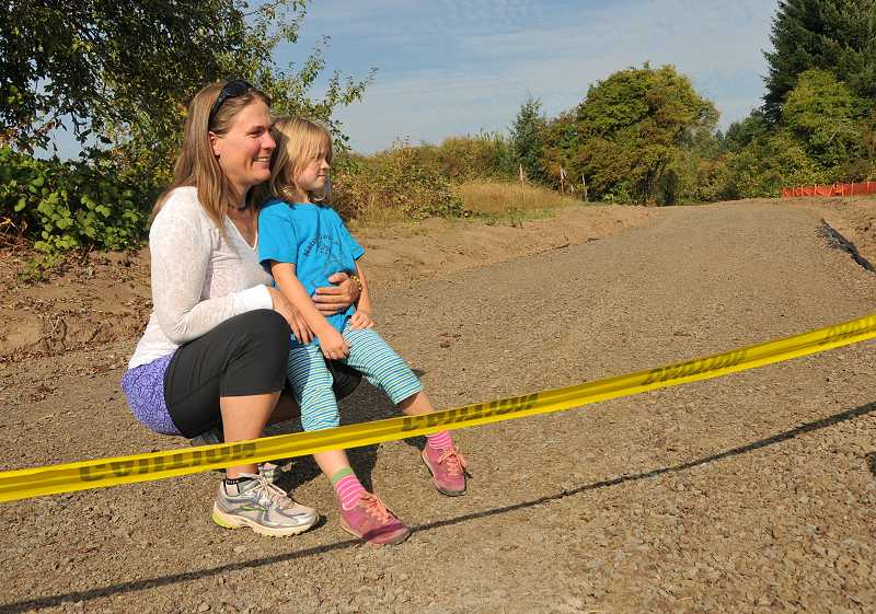 by: VERN UYETAKE - Jayne Cronlund and her daughter, Rose O'Neill, enjoy the potential of the new path connecting Lake Oswego and West Linn.