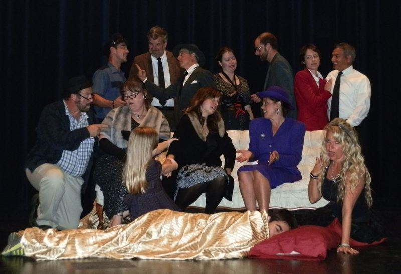 by: TOM WEAVER - The cast of 'Reserve Two for Murder.' From left front row: Ben Bongolan (on floor), Tom Weaver, Loralie Ahola, Faith Ahola, Kristen Caldwell, Vickie Weaver, Jenny Mason. Standing: Jared Weaver, Winslow Thurston, Patrick Birkle, Larianna Weaver, Skyler Weaver, Shauna Weaver and Tommy Baird.