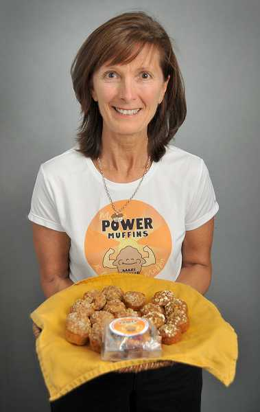 by: REVIEW PHOTO: VERN UYETAKE - Mari Brooker of Lake Oswego has founded a new business featuring her deliciious and nutritious muffins. Each is the nutritional equivalent to an egg, a piece of whole wheat toast or an apple and half a glass of milk.