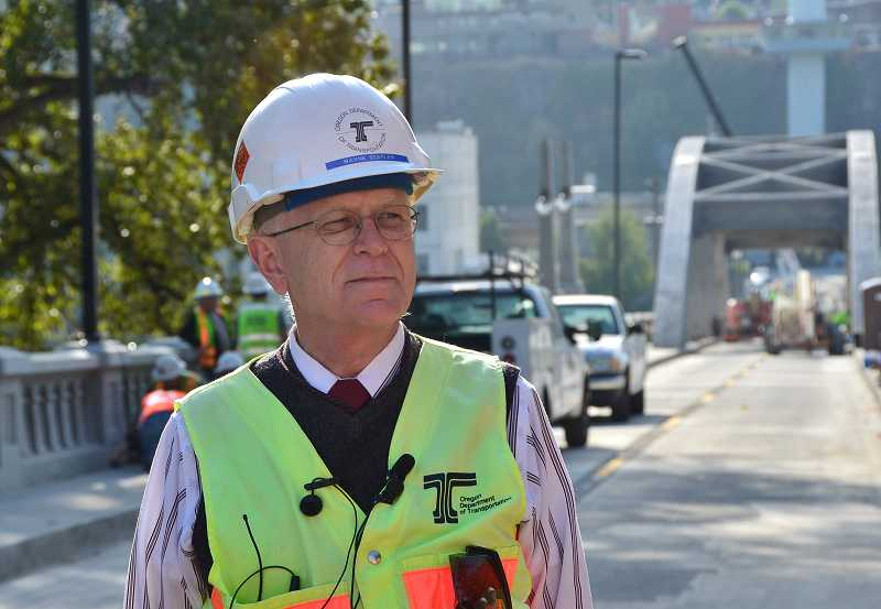 by: VERN UYETAKE - ODOT Project Manager Wayne Statler leads a tour of the almost completely renovated arch bridge.