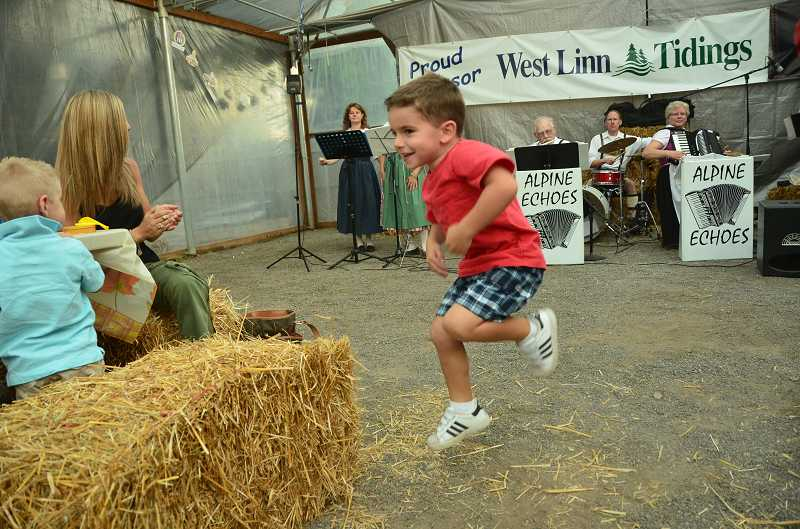 by: VERN UYETAKE - Blake Kappes, 3, of Oregon City displays his dance moves.