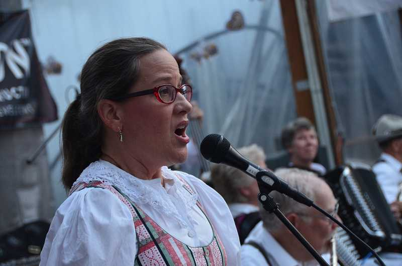 by: VERN UYETAKE - Barbara Berge of the Alpine Echoes Band belts out a tune.