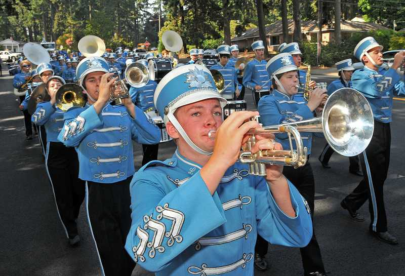 by: VERN UYETAKE - Lakeridge High School celebrated homecoming last week and Pacer spirit was sky high. The marching band put in extra practices to prepare for the parade and the halftime entertainment. Pictured marching down A Avenue are, from left, Danny Shapiro, Nick Abbot in front, Caleb Warden and Greg Conan.