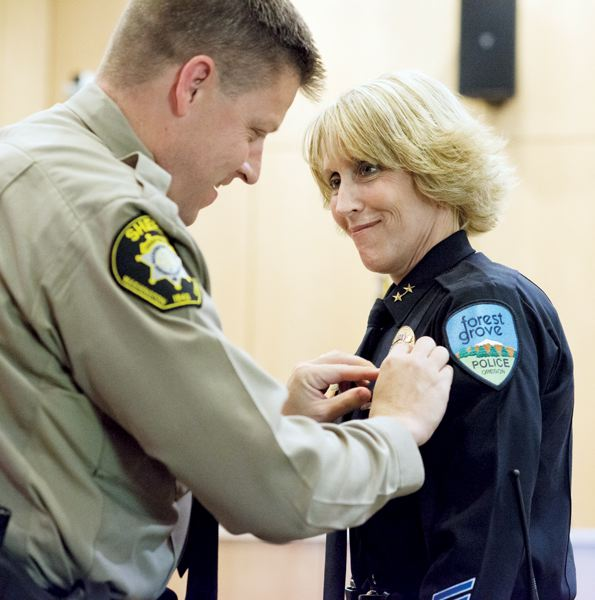 by: NEWS-TIMES PHOTO: CHASE ALLGOOD - Janie Schutz, Forest Groves first female police chief, was sworn in Monday night. Washington County Chief Deputy Bill Steele, who served in the role on an interim basis.