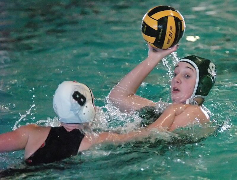 by: DAN BROOD - BATTLING -- Emily Pfeiffer of Tigard (right) looks to keep the ball away from Tualatin's Zoe Linford.