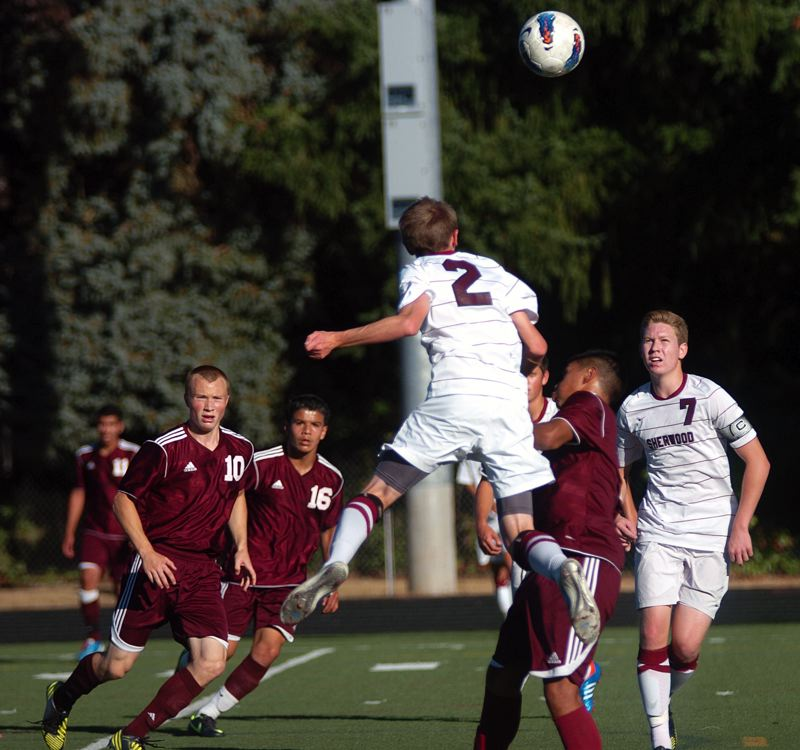 by: DAN BROOD - LAUNCHING IT -- Sherwood sophomore Connor Carraher heads the ball up high during the match with Franklin.