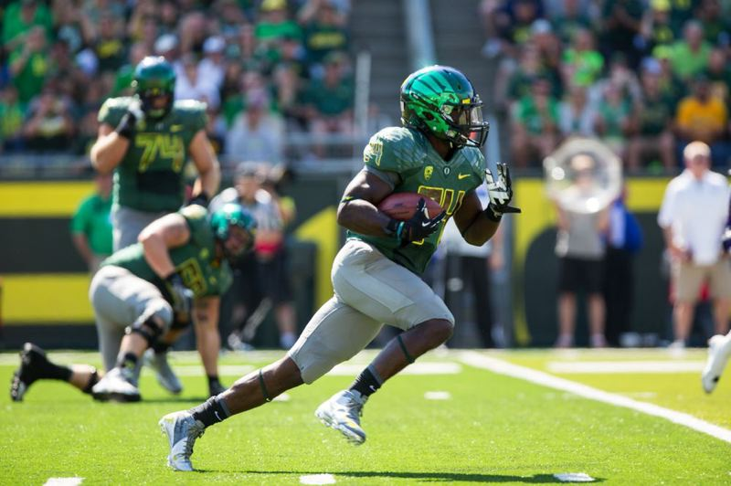 by: TRIBUNE PHOTO: CHRISTOPHER ONSTOTT - Oregon Ducks coach Chip Kelly says he is 'excited' about the 'edge' he sees in primary running back Kenjon Barner.