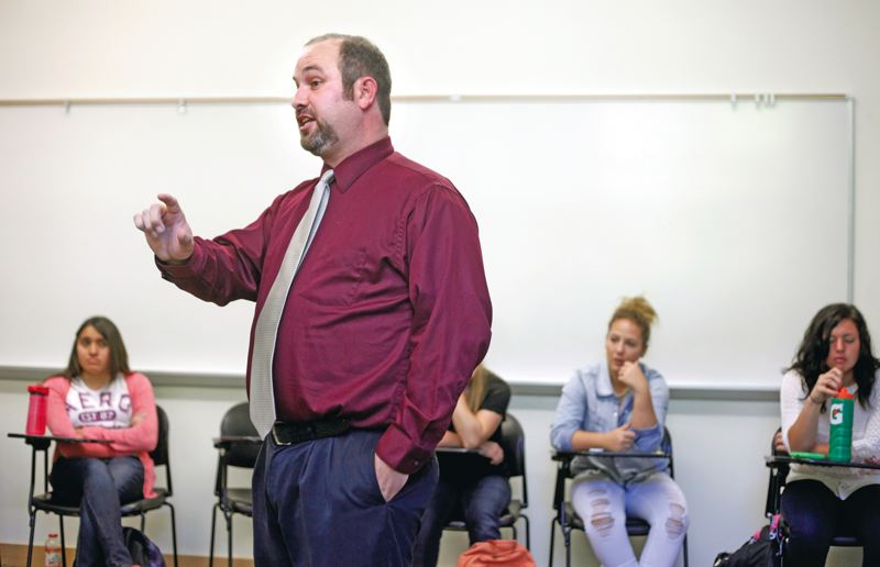 by: TRIBUNE PHOTO: JON HOUSE - Lewis & Clark professor Joe Gantt explains to debate students that knowledge is great but tap dancing works too.