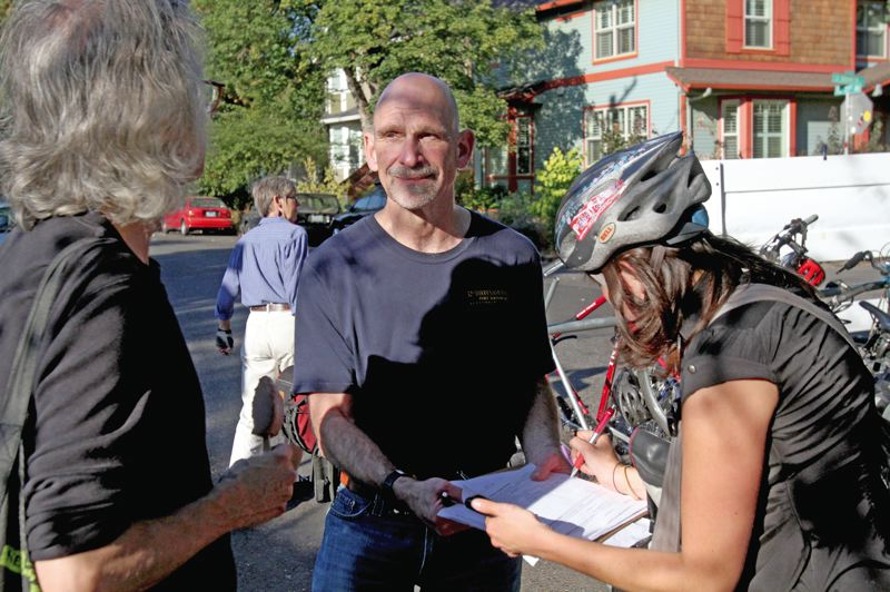 by: TRIBUNE PHOTO: JONATHAN HOUSE - Volunteer Jeff Cohen gathers signatures at the People's Food Co-op Farmer's Market, in hopes of letting Portlanders vote on whether the city should fluoridate water from the Bull Run Reservoir.