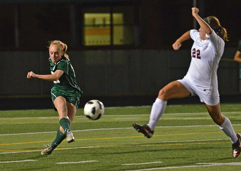by: VERN UYETAKE - West Linn freshman Juliana Guthner clears a ball in the Lions' 1-1 draw against Clackamas on Tuesday.