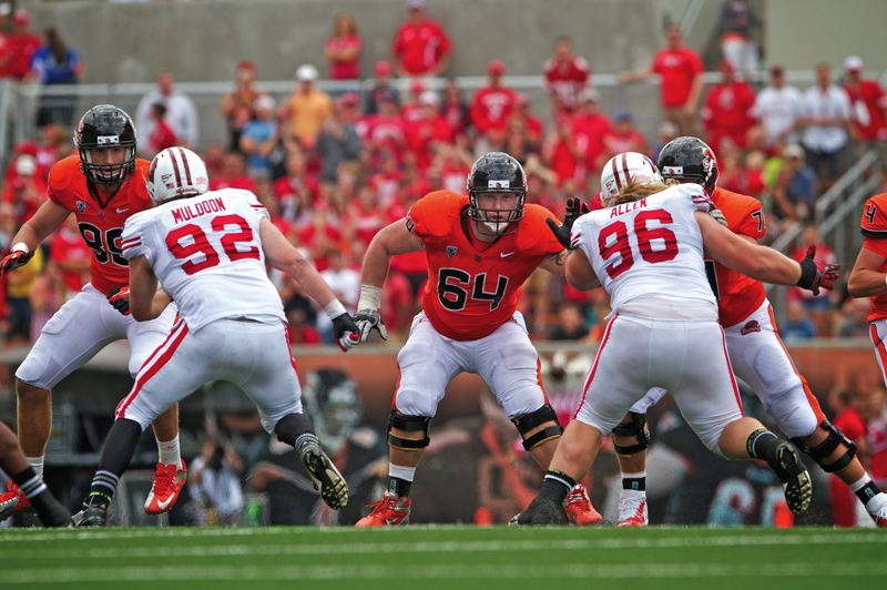 by: ETHAN ERICKSON/OREGON STATE UNIVERSITY - The offensive line has been a key to Oregon State's 3-0 start. Tight end Collin Hamlett (left) and Colin Kelly (center) work against Wisconsin's defensive line in the season opener.