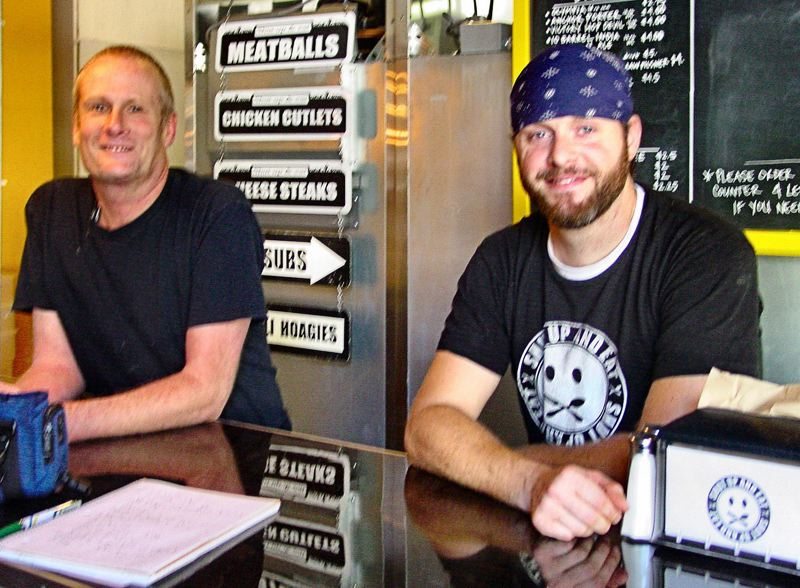 by: MERRY MACKINNON - 'Shut Up and Eat's' co-owners Glenn Hollenbeck and John Fimmano opened their Italian-American-inspired sandwich shop last July, in the 3800 block of S.E. Gladstone Street. Business has been 'fantastic', the partners report.