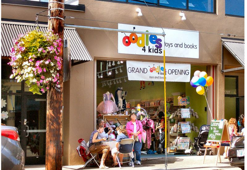 by: RITA A. LEONARD - A snapshot of the storefront at the Grand Opening of 'Oodles 4 Kids' on S.E. 13th Avenue.