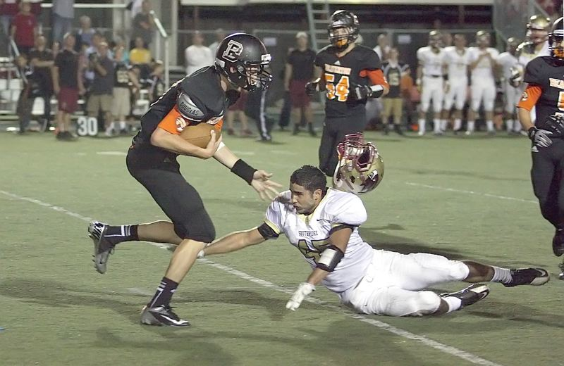 by: MILES VANCE - HAT FREE - Southridge linebacker Andrew Ripley-Miles loses his helmet while trying to make a tackle on Beaverton quarterback Bryce Barker during the Skyhawks 23-13 win over the Beavers at Beaverton High School on Friday night.