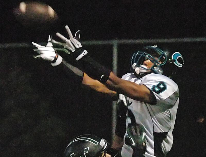 by: PHOTO BY DAN BROOD - Century senior Xavier Mitchell goes up over Tigards Manu Rasmussen in the back corner of the end zone to pull in a touchdown on Sept. 21.