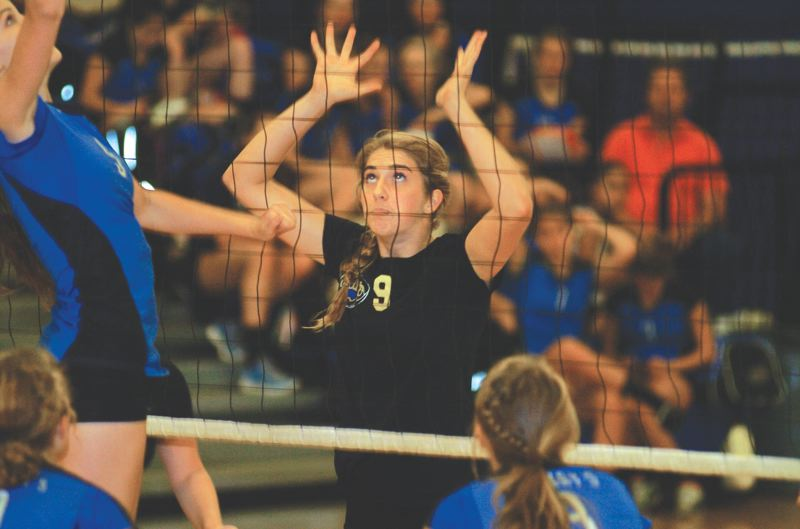 by: THE OUTLOOK: DAVID BALL - Barlow middle blocker Cassidy Winters prepares for a St. Marys attack during Thursdays three-set sweep.