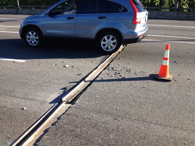 by: COURTESY OF ODOT - An expansion joint on Interstate 5 near the Fremont Bridge popped up Friday morning, forcing ODOT to block one lane while repairs were made.