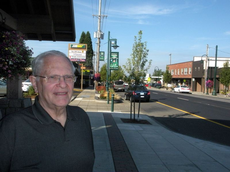 by: POST PHOTO: JIM HART - George Hoyt, chairman of the Sandy Main Street Steering Committee, stands in the middle of Sandys commercial zone. Hoyts views on how to build the citys Main Street programs is not popular with some landowners.