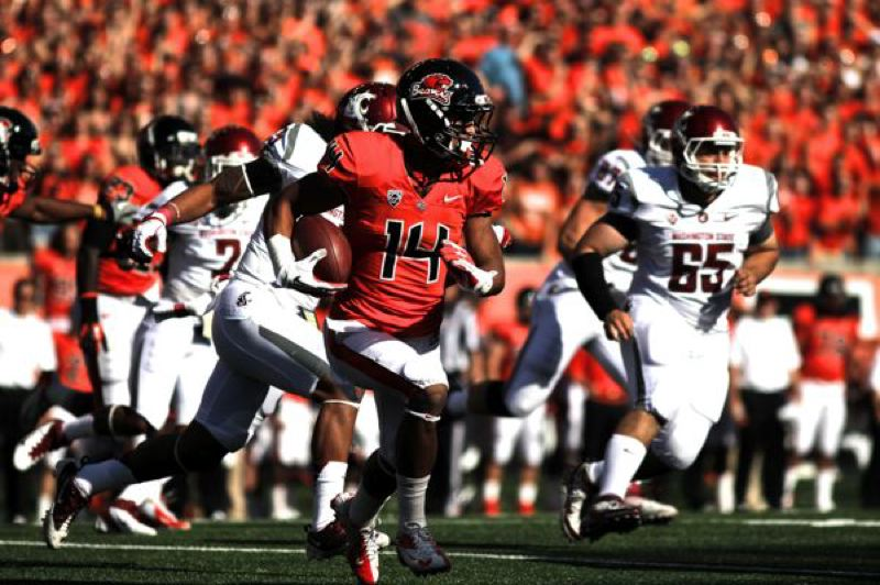 by: TRIBUNE PHOTO: JAIME VALDEZ - Oregon State defensive back Jordan Poyer returns the first of his three interceptions in Saturday's 19-6 home victory over Washington State