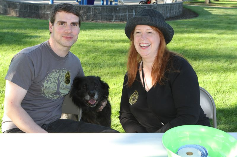 by: DAVID F. ASHTON - Matt Rinker (and his pooch Loki), along with Chris Davis, welcome guests to Ardenwald-Johnson Creek neighborhood concert series.