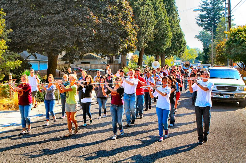 by: DAVID F. ASHTON - The Milwaukie Mustang Band announces the approach of the annual Ardenwald Parade, bringing neighbors out to see it pass.