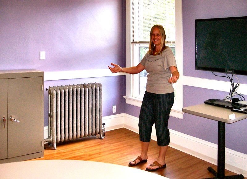 by: RITA A. LEONARD - Joy Leising introduces the new downstairs recreation room for the resident girls in the former Brooklyn convent building.