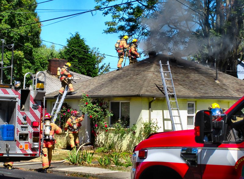 by: RITA A. LEONARD - Portland and Milwaukie firefighters work to put out a house fire in the Ardenwald neighborhood, shortly before the Labor Day weekend.