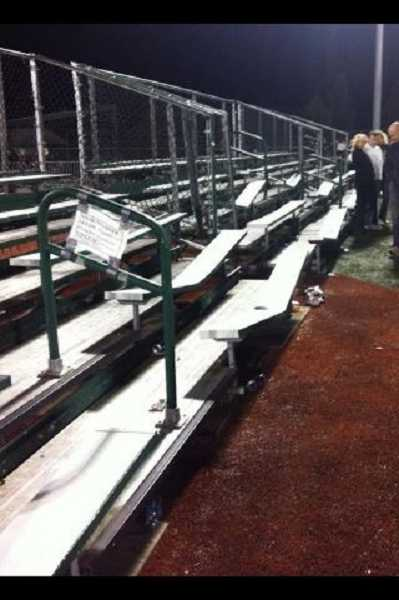 by: PETER BAUER - The visiting side bleachers at Tigard High School after Friday's 41-0 victory against Tualatin.